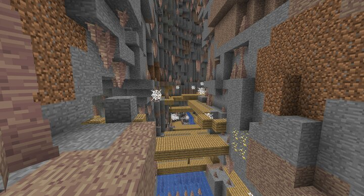 A dripstone mineshaft inside a dripstone ravine with night vision