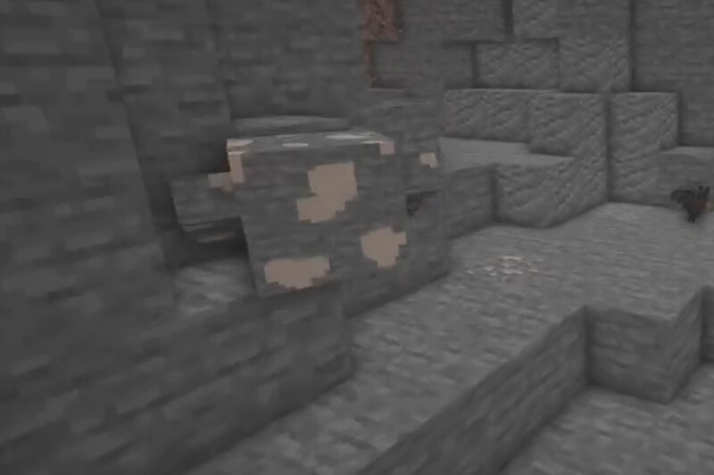 An iron Mineral Dweller staring at stone.