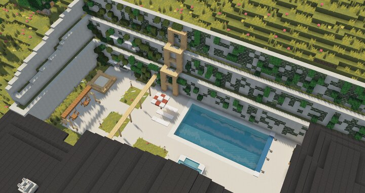 View of the garden in the rear with the large retaining wall, featuring a pool, hot tub, swing set, sand pit and seating areas.