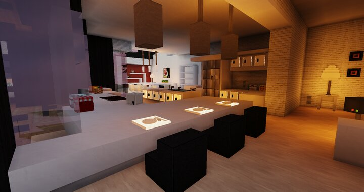 View of the minimalistic kitchen and the dining room on the left, and the living room on the right.