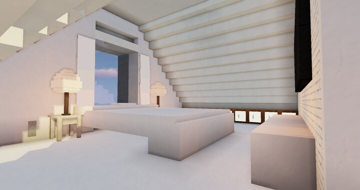 Screenshot of the master suite, featuring a small seating area and an ensuite.