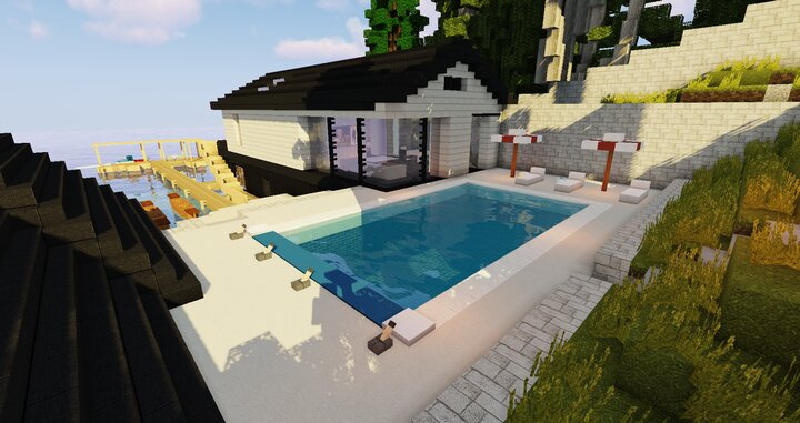 View of the back of the guesthouse  boathouse with the swimming pool.