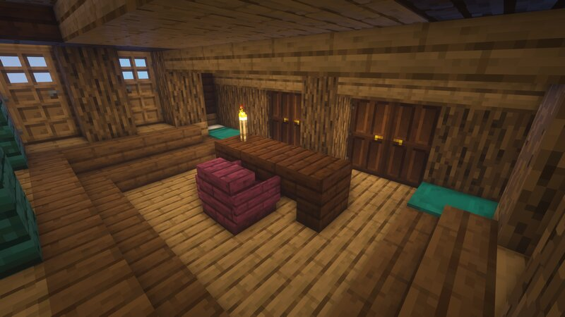 The Upper Captain's Quarters feature two beds, a plush chair, and a desk perfect for charts and maps