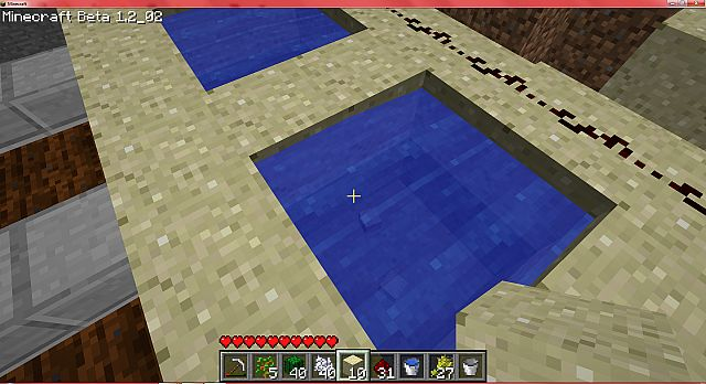 take away 4 sand blocks under the water to make a 4x4 square of water