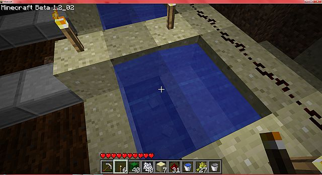 then place the 4 sand blocks you took away in step 2 back to look like the picture and the water is flowing towards the red stone