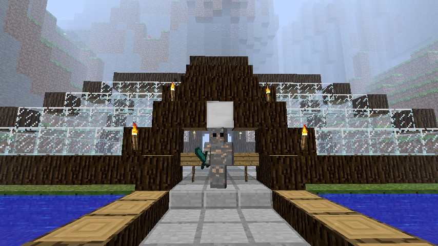 The owner of the server stands by the spawn building.