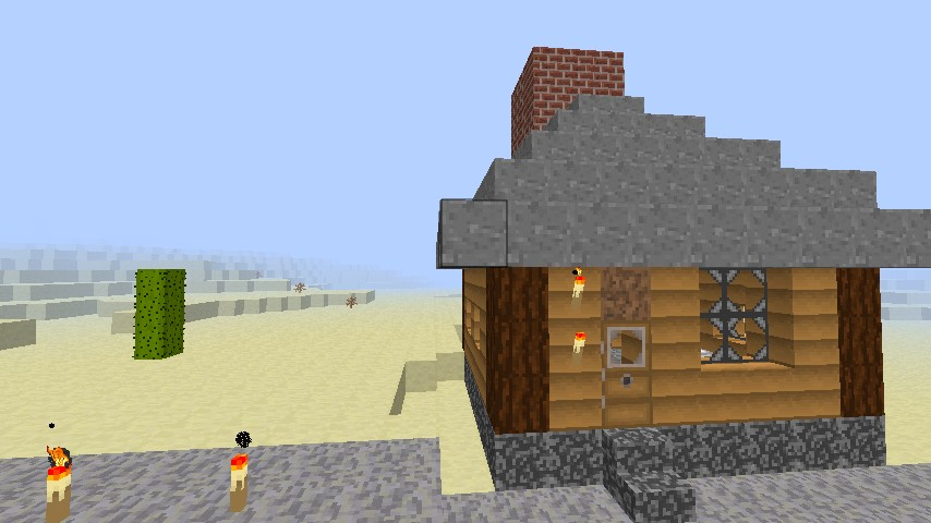 One of my houses displaying stone, dark wood, doors, bricks, torches, and wooden planks.