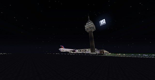 The airport from the runway looking at the control tower at night