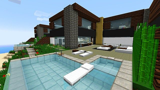 Back patio with an infinity pool, sitting area, and grill