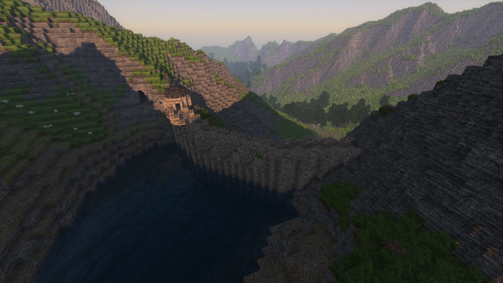 A dam in the mountains above, supplying the mine with water