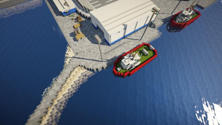 Tug boats, warehouse, and multiple low-density industrial stuff, near a breakwater
