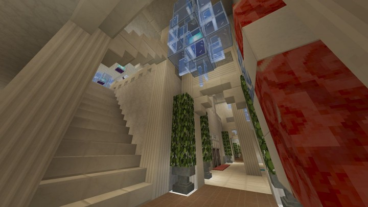 One of the two stairways to 2F. Has a tall ceiling with a chandelier as well.