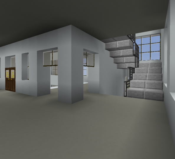 The end of the hallway has a smaller stairwell. The entrance to a snack shop can be seen in the corner.