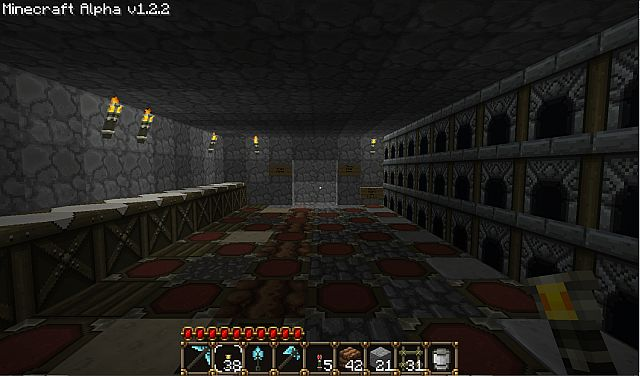 The toolshed. Forges on the right, crafting benches on the left, trash chute in the back, and storage in the floor.